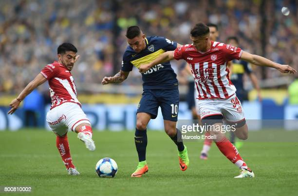 Ricardo Centurion of Boca Juniors fights for ball with Brian Blasi and Jonathan Fleita of Union during a match between Boca Juniors and Union as part...
