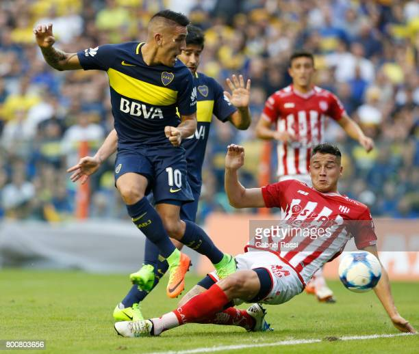 Ricardo Centurion of Boca Juniors fights for the ball with Bruno Pitton of Union during a match between Boca Juniors and Union as part of Torneo...