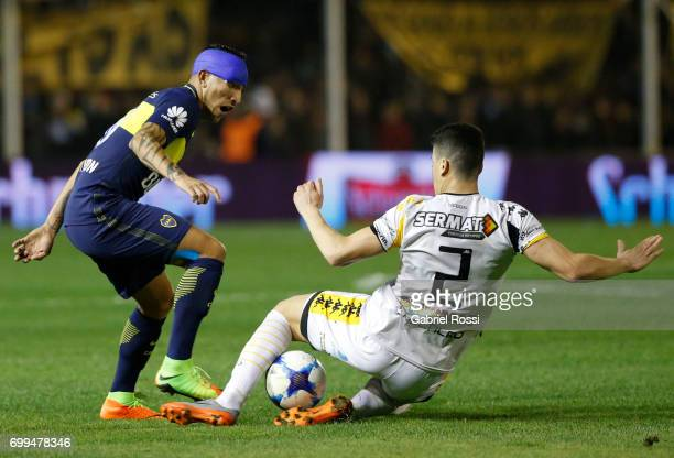Ricardo Centurion of Boca Juniors fights for the ball with Carlos Rodriguez of Olimpo during a match between Olimpo and Boca Juniors as part of...