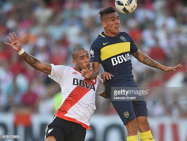Ricardo Centurion of Boca Juniors heads the ball and score the fourth goal of his team during a match between River Plate and Boca Juniors as part of...