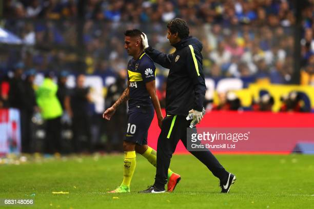 Ricardo Centurion of Boca Juniors leaves the field through injury during the Torneo Primera Division match between Boca Juniors and River Plate at...