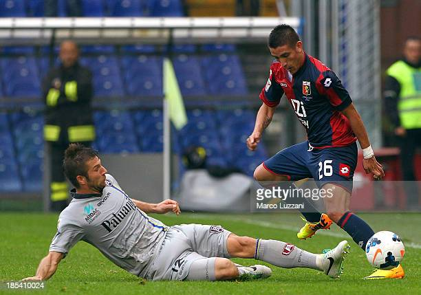 Ricardo Centurion of Genoa CFC competes for the ball with Bostjan Cesar of AC Chievo Verona during the Serie A match between Genoa CFC and AC Chievo...