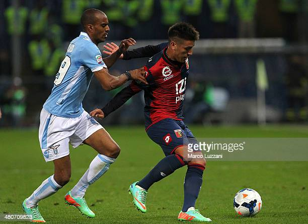 Ricardo Centurion of Genoa CFC is challenged by Abdoulay Konko of SS Lazio during the Serie A match between Genoa CFC and SS Lazio at Stadio Luigi...