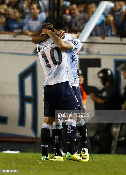 Ricardo Centurion of Racing Club celebrates with his teammate Gustavo Bou after scoring the opening goal during a match between Racing Club and Godoy...