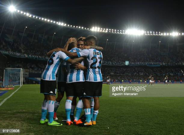 Ricardo Centurion of Racing Club celebrates with teammates after scoring the second goal of his team during a match between Racing Club and Lanus as...
