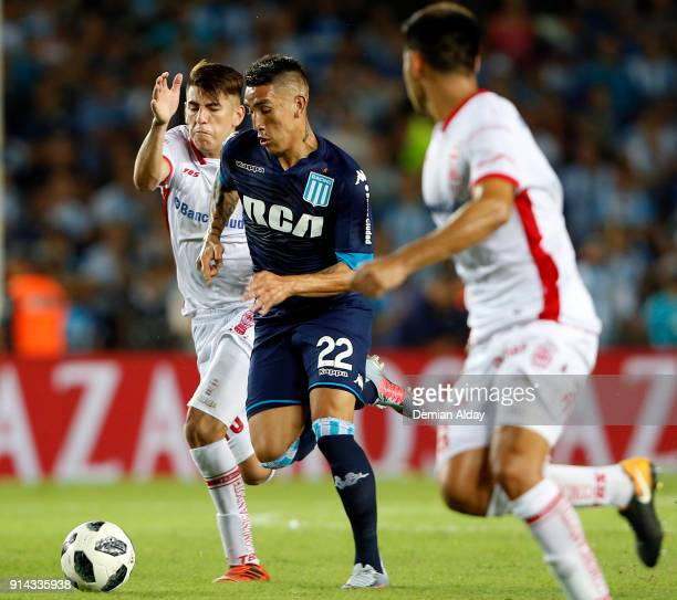 Ricardo Centurion of Racing Club fights for the ball with Lucas Villalva of Huracan during a match between Racing Club and Huracan as part of...