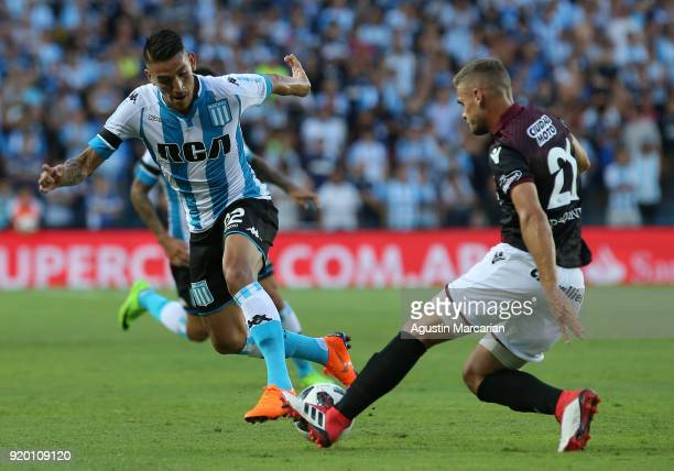 Ricardo Centurion of Racing Club fights for the ball with Nicolas Pasquini of Lanus during a match between Racing Club and Lanus as part of Argentine...
