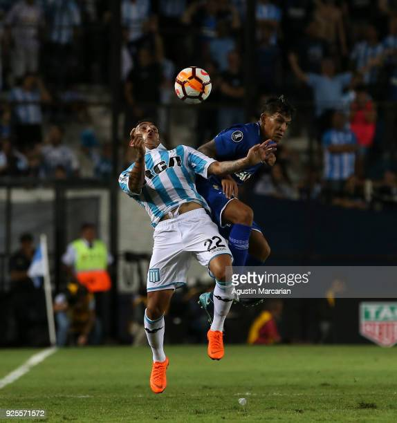 Ricardo Centurion of Racing fights for the ball with Lucas Romero of Cruzeiro during a Group E match between Racing Club and Cruzeiro as part of Copa...
