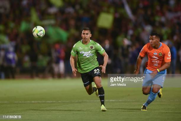 Ricardo Chavez of Juarez fights for the ball with Roger Martinez of America during the final match of Copa MX 2019 between FC Juarez and America at...
