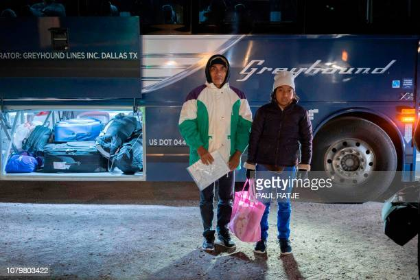 Ricardo ChubBo and his daughter Rosa Maria from Poptún in the El Petén department of Guatemala pose in front of a Greyhound bus on January 3 2019 in...