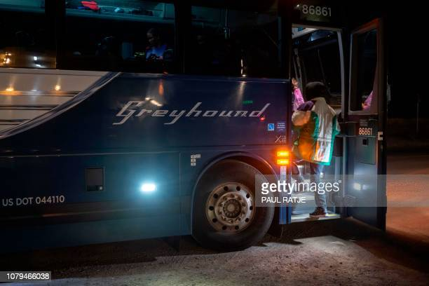 Ricardo ChubBo and his daughter Rosa Maria from Poptun in El Petun department Guatemala board the Greyhound bus they will take to Albuquerqe before...