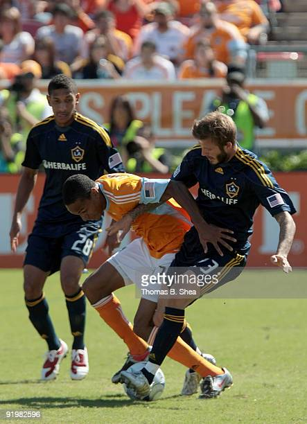 Ricardo Clark of the Houston Dynamo defends the ball from David Beckham of the Los Angeles Galaxy at Robertson Stadium on October 18 2009 in Houston...