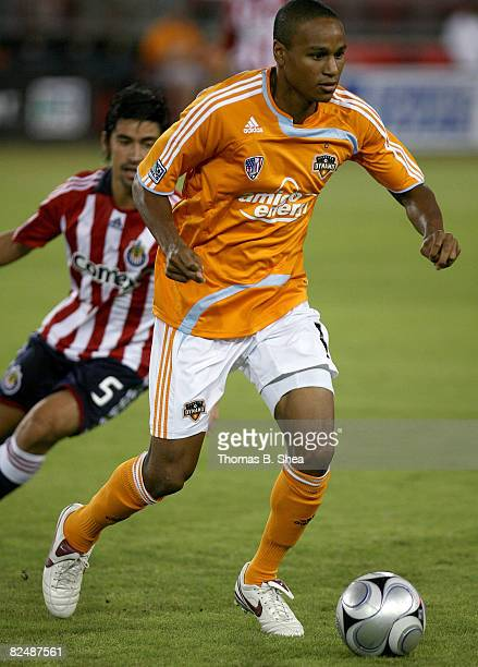 Ricardo Clark of the Houston Dynamo fights for the ball against Paulo Nagamura of Chivas USA at Robertson Stadium August 20 2008 in Houston Texas