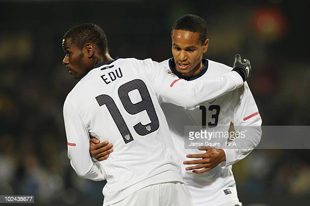 Ricardo Clark of the United States shakes hands with substitute Maurice Edu during the 2010 FIFA World Cup South Africa Round of Sixteen match...