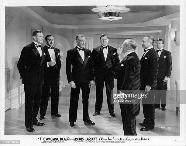 Ricardo Cortez Barton MacLane Edmund Gwenn and other men gathered in room together in a scene from the film 'The Walking Dead' 1936