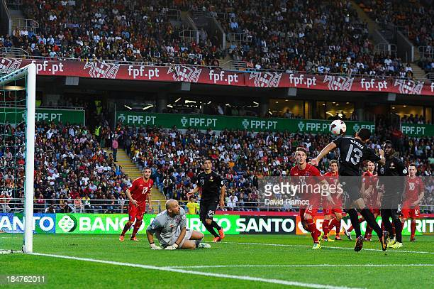 Ricardo Costa of Portugal heads the ball towards goal during the FIFA 2014 World Cup Qualifier match between Portugal and Luxembourg at Estadio...