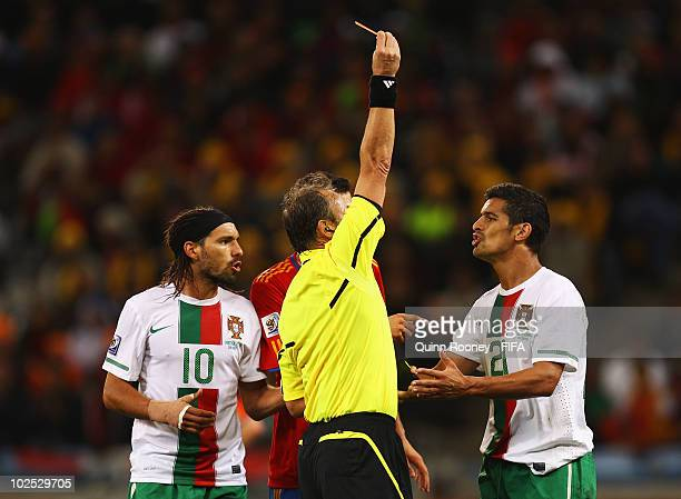 Ricardo Costa of Portugal is given a straight red card be Referee Hector Baldassi as teammate Danny argues during the 2010 FIFA World Cup South...
