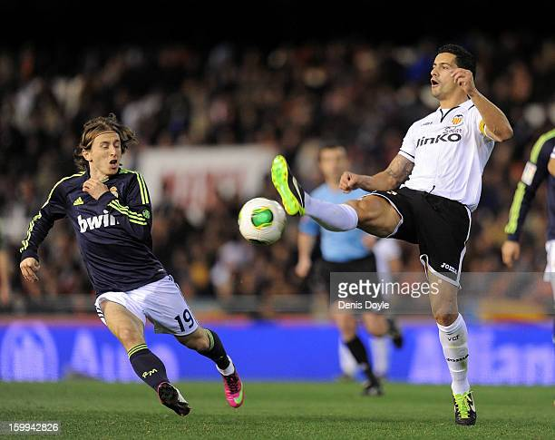 Ricardo Costa of Valencia CF battles for the ball against Luka Modric of Real Madrid CF during the Copa del Rey Quarter Final second leg match...
