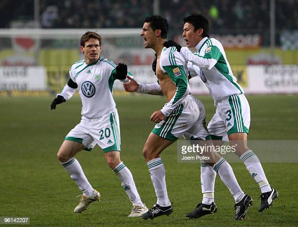 Ricardo Costa of Wolfsburg celebrates with his team mates after scoring his team's second goal during the Bundesliga match between VfL Wolfsburg and...