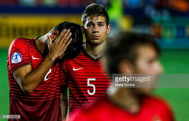 Ricardo Esgaio and Raphael Guerreiro of Portugal show dejection after UEFA U21 European Championship final match between Portugal and Sweden at Eden...