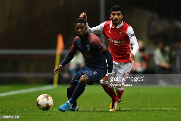 Ricardo Esgaio of Sporting Braga competes for the ball with Eljero Elia of Basaksehir FK during the UEFA Europa League group C match between Sporting...