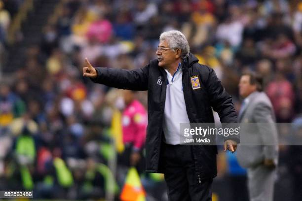 Ricardo Ferretti Coach of Tigres gives instructions to his players during the semifinal first leg match between America and Tigres UANL as part of...
