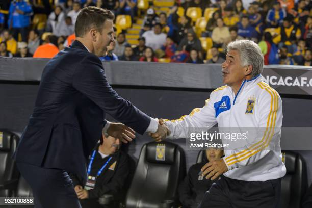 Ricardo Ferretti coach of Tigres shake hands with Greg Vanney coach of Toronto prior the quarterfinals second leg match between Tigres UANL and...