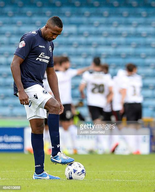 Ricardo Fuller of Millwall FC looks dejected as Rotherham United celebrate scoring the first goal during the Sky Bet Championship match between...