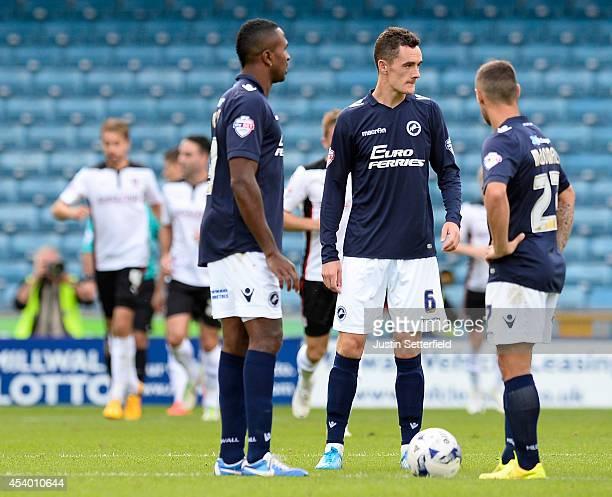 Ricardo Fuller of Millwall FC, Shaun Williams of Millwall FC and Scott McDonald of Millwall FC look dejected as Rotherham United celebrate scoring...
