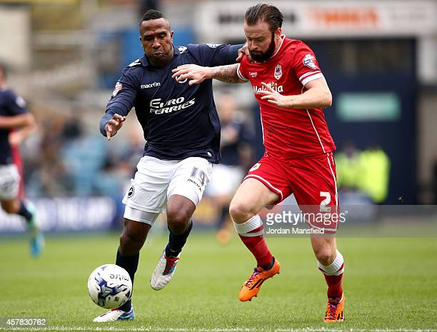 Ricardo Fuller of Millwall tackles with John Brayford of Cardiff during the Sky Bet Championship match between Millwall and Cardiff City at The Den...