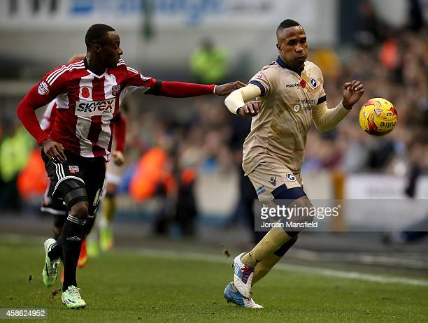 Ricardo Fuller of Millwall takes the ball past Moses Odubajo of Brentford during the Sky Bet Championship match between Millwall and Brentford at The...