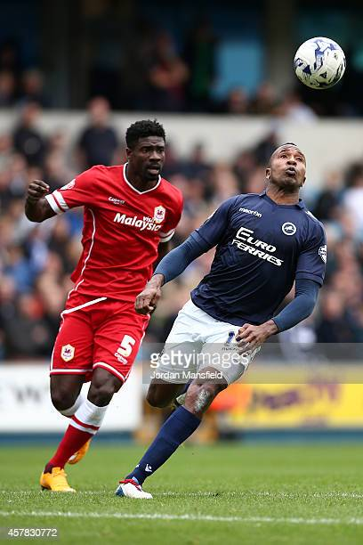 Ricardo Fuller of Millwall watches the ball over his head under pressure by Bruno Ecuele Manga of Cardiff during the Sky Bet Championship match...