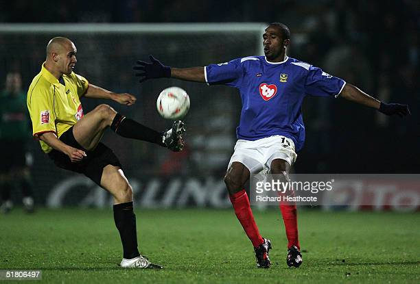 Ricardo Fuller of Portsmouth and Gavin Mahon of Watford challenge for the ball during the Carling Cup Quarter final match between Watford and...
