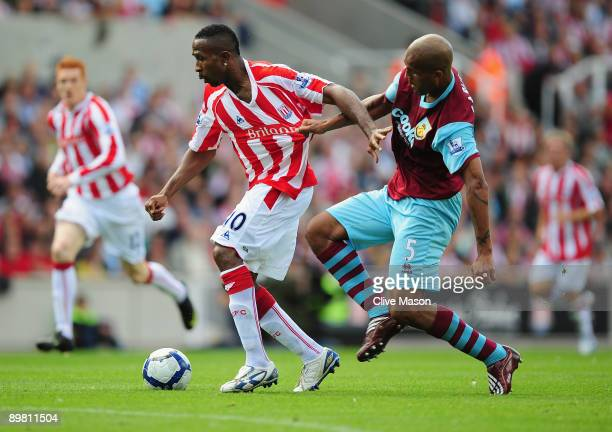 Ricardo Fuller of Stoke City is challenged by Clarke Carlisle of Burnley during the Barclays Premier League match Between Stoke City and Burnley at...