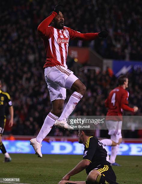 Ricardo Fuller of Stoke City leaps above Jamie Carragher of Liverpool to celebrate after scoring the first goal during the Barclays Premier League...