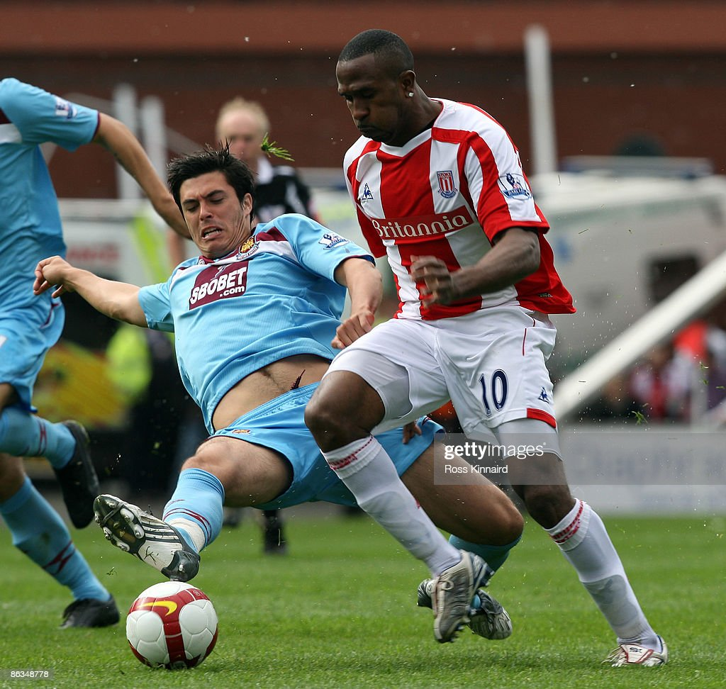 Ricardo Fuller of Stoke is challenged by James Tomkins of West Ham during the Barclays Premier League match between Stoke City and West Ham United at the Britannia Stadium on May 2, 2009 in Stoke, England.