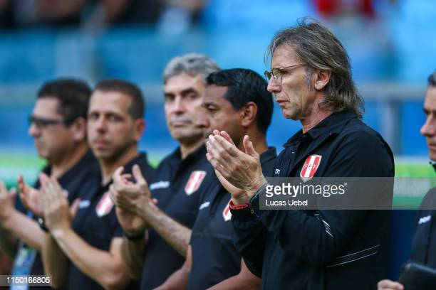 Ricardo Gareca coach of Peru applauds during the Copa America Brazil 2019 Group A match between Venezuela and Peru during at Arena do Gremio stadium...