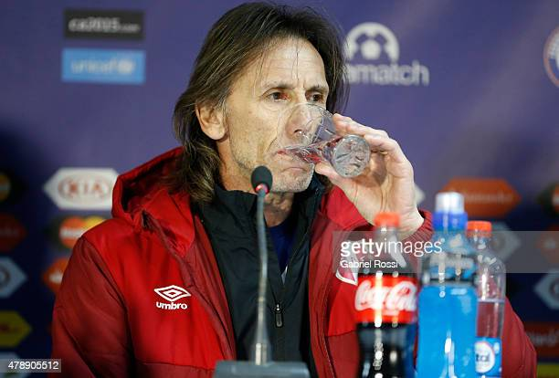 Ricardo Gareca coach of Peru drinks water during a press conference prior to the semi final match against Chile at Nacional Stadium as part of 2015...