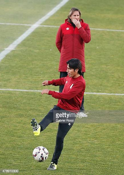 Ricardo Gareca, coach of Peru gestures during a field scouting prior to the semi final match against Chile at Nacional Stadium as part of 2015 Copa...