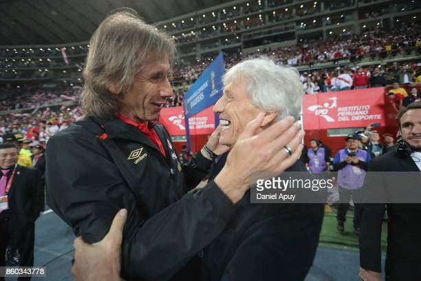 Ricardo Gareca coach of Peru greets Jose Pekerman coach of Colombia prior to a match between Peru and Colombia as part of FIFA 2018 World Cup...