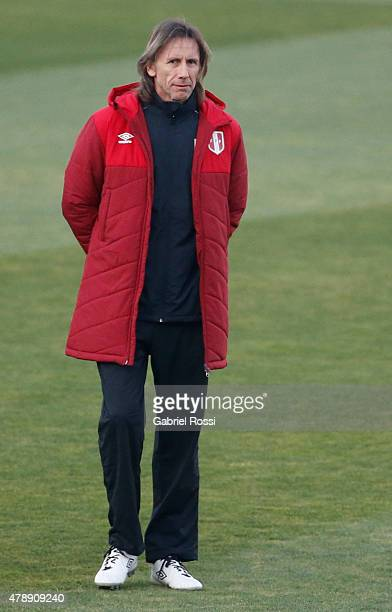 Ricardo Gareca, coach of Peru, looks on during a field scouting prior to the semi final match against Chile at Nacional Stadium as part of 2015 Copa...