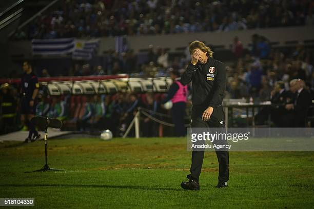 Ricardo Gareca coach of Peru reacts during a match between Uruguay and Peru as part of FIFA 2018 World Cup Qualifiers at Centenario Stadium on March...