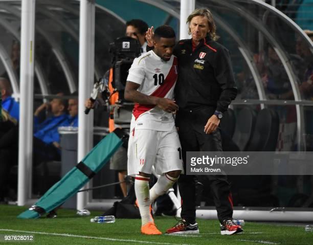 Ricardo Gareca coach of Peru talks to Jefferson Farfan during the international friendly match between Peru and Croatia at Hard Rock Stadium on March...