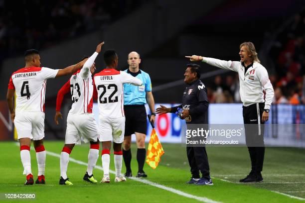 Ricardo Gareca, Head Coach / Manager of Peru speaks to goal scorer Pedro Aquino of Peru during the International Friendly match between Netherlands...