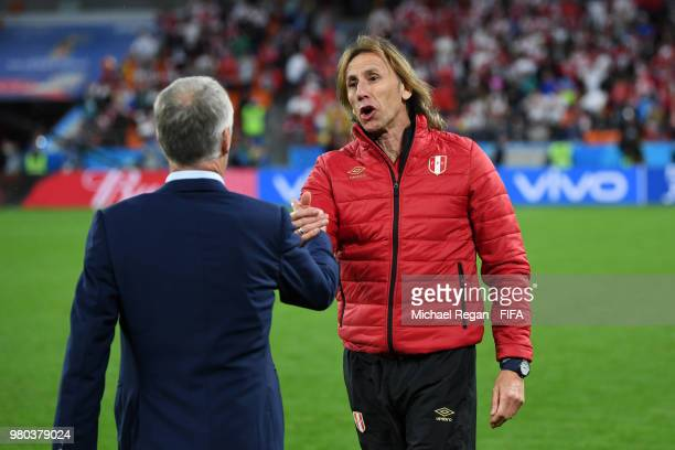 Ricardo Gareca Head coach of Peru cheers Didier Deschamps Manager of France during the 2018 FIFA World Cup Russia group C match between France and...