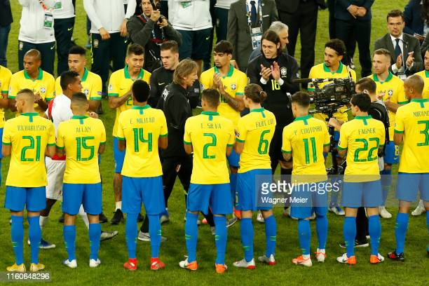 Ricardo Gareca head coach of Peru is applauded by players of Brazil after the Copa America Brazil 2019 Final match between Brazil and Peru at...