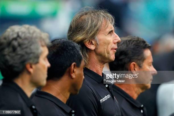 Ricardo Gareca head coach of Peru looks on during the Copa America Brazil 2019 quarterfinal match between Uruguay and Peru at Arena Fonte Nova on...