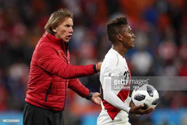 Ricardo Gareca Head coach of Peru speaks with Pedro Aquino of Peru during the 2018 FIFA World Cup Russia group C match between France and Peru at...
