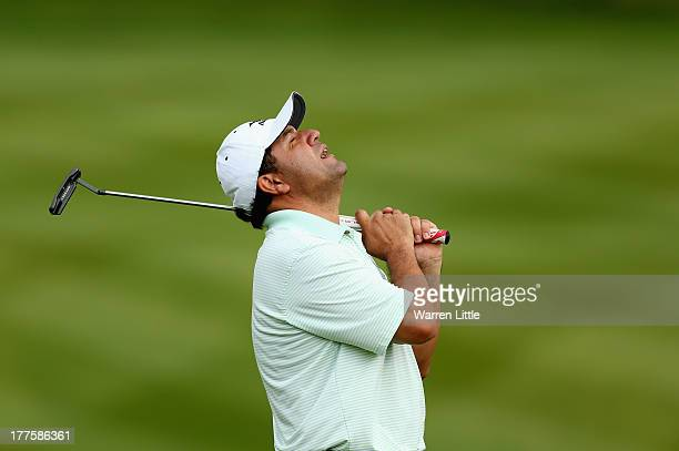 Ricardo Gonzalez of Argentina reacts to a missed birdie putt on the 18th green during the third round of the Johnnie Walker Championship at...