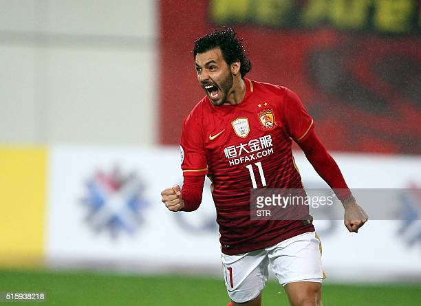 Ricardo Goulart of China's Guangzhou Evergrande celebrates after scoring a goal during the AFC Champions League group stage football match against...